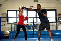 Boxer training with coach in ring