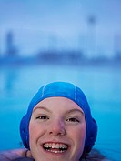 Woman in braces swimming