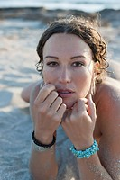 Close up of sand covered woman on beach