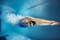 Swimmer diving into pool