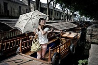 Woman on a boat in Tong Li. China country
