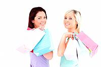 Cheerful women with shopping bags in a studio