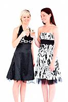 Smiling women in beautiful dresses toasting with champaign in a studio