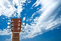 Guitar on cloudy sky bakcground!