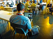 Perpignan, France, Man Looking at Photo Website on Laptop Computer Screen in Office, Visa Pour l'Image Photo Festival