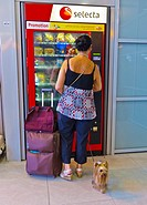 Paris, France, French Woman Buying Snacks at Vending Machine in Train Station