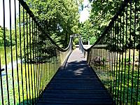 Old Footbridge in a country estate Denmark in perspective