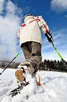 Woman walking with snowshoes, La Molina ski resort, Girona, Catalonia. Spain