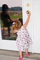 Unsupervised child tries to open a door