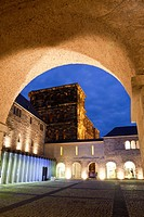 Brunnenhof with Porta Nigra, World Heritage Site, illuminated at night, Trier, Germany