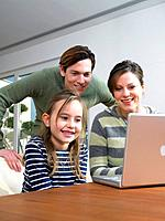 Young Family Using Laptop