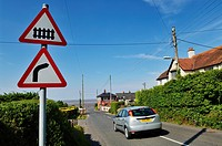 Warning road signs on the approach to the level crossing at Blue Anchor, Somerset, England, United Kingdom