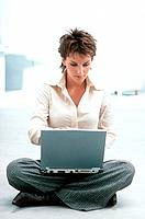 Woman Sitting on Floor Using Laptop