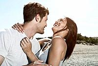 Spain, Majorca, Young couple kissing each other, smiling