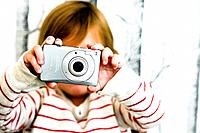 Little boy playing with a digital camera