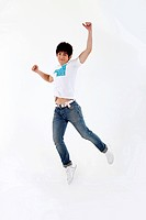 college student jumping on air