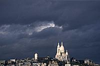 The basilica Sacre Coeur under clouded sky, Montmartre, Paris, France, Europe