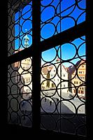 View through a window of the town hall to Ratstrinkstube and houses with stepped gables at the Marketplace, Rothenburg ob der Tauber, Tauber valley, R...