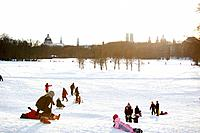 Children playing in snow, English Garden, Munich, Bavaria, Germany