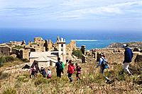 hiker to the Ruins on Capo d´Occi above Algajola village, North_west coast, Balagne region, Corsica, France, Europe