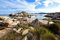family in the rocks on the beach of Palombaggia, south_east coast, Corsica, France, Europe