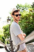 Man leaning against a railing, Montmartre, Paris, Ile_de_France, France