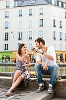 Couple toasting with wineglasses, Paris, Ile-de-France, France (thumbnail)