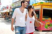Couple walking in amusement park, Jardin des Tuileries, Paris, Ile_de_France, France