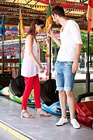 Couple in an amusement park, Paris, Ile_de_France, France