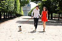 Couple running in a garden with a puppy, Terrasse De l'Orangerie, Jardin des Tuileries, Paris, Ile_de_France, France