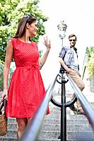 Woman waving to her husband, Montmartre, Paris, Ile_de_France, France