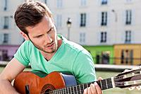 Man playing a guitar, Canal St Martin, Paris, Ile_de_France, France