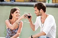 Couple toasting with wineglasses, Paris, Ile_de_France, France
