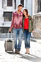 Couple walking on a road with a suitcase, Paris, Ile_de_France, France