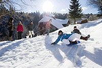 Children playing in snow, St Peter, Black Forest, Baden_Wurttemberg, Germany