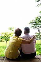 Senior Hispanic couple sitting outdoors together
