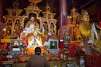 Golden Buddha statues in the Prayers hall at Drepung monastery n, Tibet Autonomous Region, People´s Republic of China