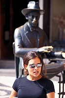 Person in front of Pessoa Statue, Bairro Alto, Lisbon, Portugal, Europe