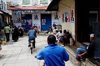 Street life, people in Hurumzi Street in Stonetown, Zanzibar City, Zanzibar, Tanzania, Africa