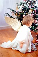 Angel in front of christmas tree