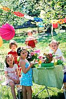 Children´s birthday party in garden, summer, group portrait