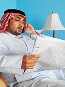 Arab man reading newspaper