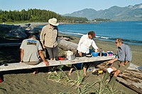 campers cook a meal on the beach on Nootka Island, BC, Canada