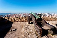 Sao Jorge St  George Castle in Lisbon, Portugal  Old Bronze cannon and a view of the Lisbon &#8220;Baixa&#8221; downtown and Tagus River