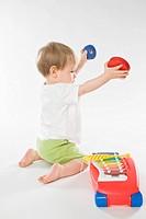 baby boy playing on dulcimer