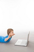 Baby on floor with laptop