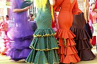 Flamenco dancers in traditional dresses