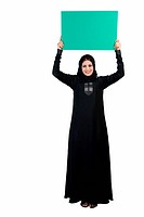 Arab woman holding a placard