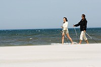 couple hiking on beach