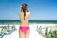 back of woman on beach